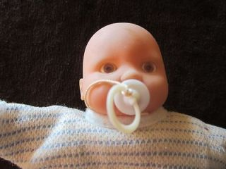 Vintage Hong Kong made cloth and rubber face Baby, with pacifier in