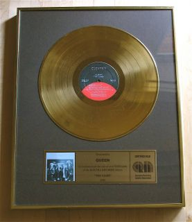 Gold Record Award Presented to Queen Freddie Mercury Brian May
