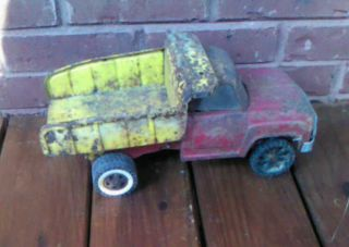 Vintage Rustic Red and Yellow Dually Dump Tonka Truck