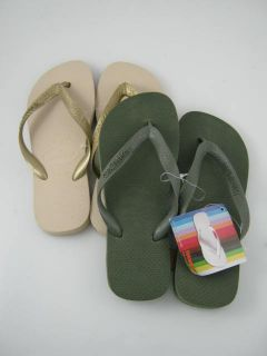 on a pair of lot 2 nwt havaianas kids tan olive flip flops in a size 6
